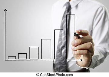 Businessman drawing graphics growing graph - Businessman...