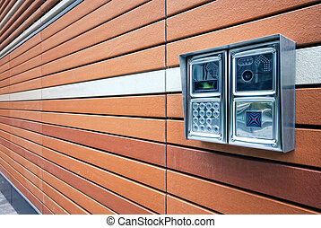 Modern Door Intercom - Shiny stainless steel intercom at a...