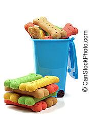 rubbish bin and stack of dog treats - rubbish bin full of...