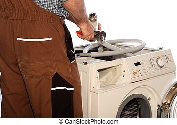 worker is repairing a clothes washer on white background