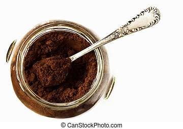 Ground coffee in a glass jar
