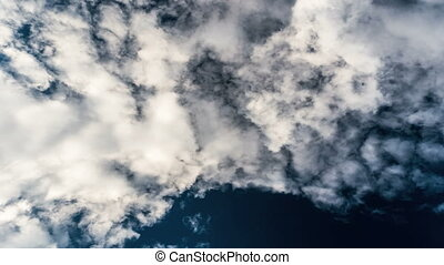 Blue sky and white clouds up view from ground, 4k