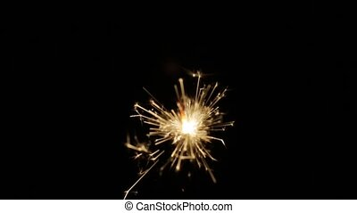 burning sparkler or bengal light in darkness - holidays, new...