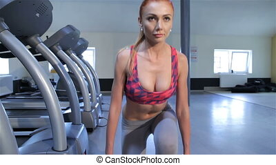 Woman trains gluteal muscles at the fitness centre - Close...