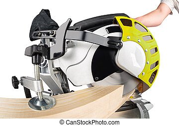 miter saw at work - miter saw cutting a wooden beam