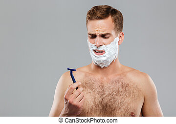 Portrait of a pensive man before shaving