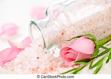 Bath salts - Pink bath salts in a glass jar with flowers and...