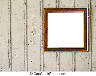Empty photo frame hanging on wooden wall