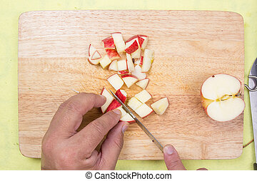 chef cutting apple before cooking cooking steak concept