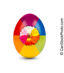 multicolored easter egg decorated with gebera blossom