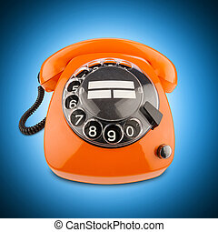 orange retro phone - an old orange phone with rotary dial