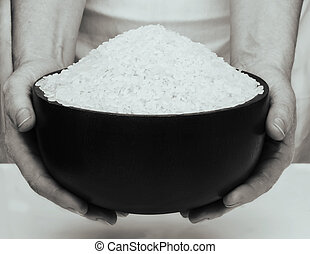 Rice in the hands on white background