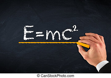 theory of relativity e=mc2 - chalk board with hand and...