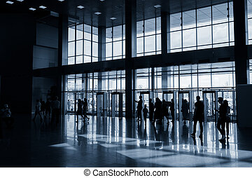 Silhouettes of people in modern hall - Silhouettes of people...