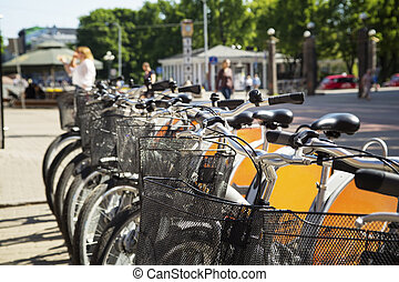 Parked bicycles on the street. - Parked bicycles on the...