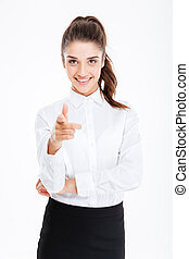 Young smiling businesswoman pointing at camera