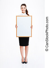 Young smiling businesswoman holding blank board - Beautiful...