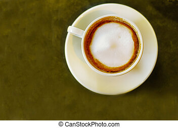cappuccino coffee from above, on textured table