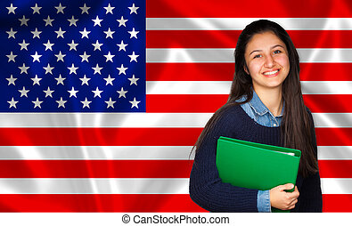 Teen student smiling over United States flag. Concept of...