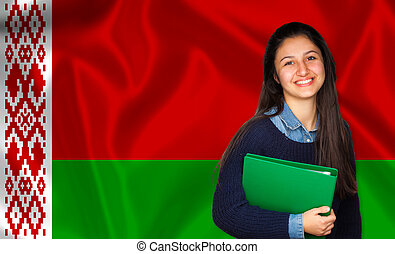 Teen student smiling over Belarusian flag Concept of lessons...