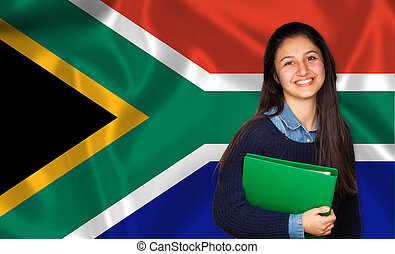Teen student smiling over South African flag. Concept of...