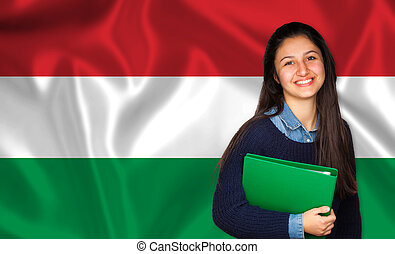 Teen student smiling over Hungarian flag. Concept of lessons...