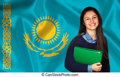 Teen student smiling over Kazakh flag. Concept of lessons...