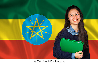 Teen student smiling over Ethiopia flag Concept of lessons...
