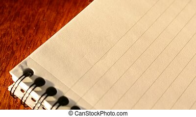 Hand writing TO DO list with a pen in notepad, top view
