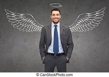 smiling businessman with angel wings and nimbus - business,...