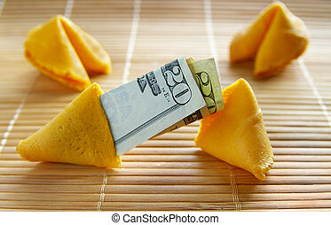 assortment of fortune cookies, one with cash inside