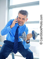 Businessman training in gym