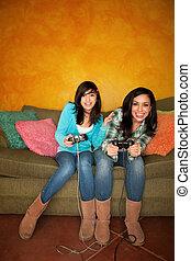 Hispanic Woman and Girl Playing Video game
