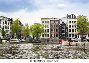 Charming houses and canal in Amsterdam, The Netherlands