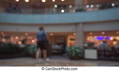 Cafe in shopping mall bokeh slow motion video