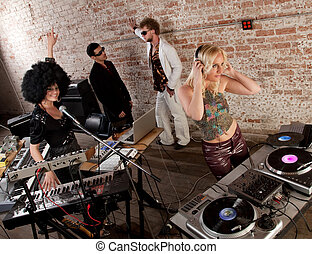 1970s Disco Music Party - Female DJs performing at a 1970s...