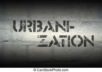 urbanization stencil print on the grunge white brick wall
