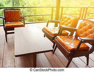wooden sofa with leather seat with burst light