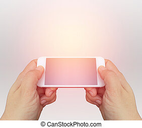hand holding the smartphone on background with burst light