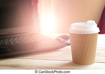 coffee cup and office desk with laptop computer with burst...