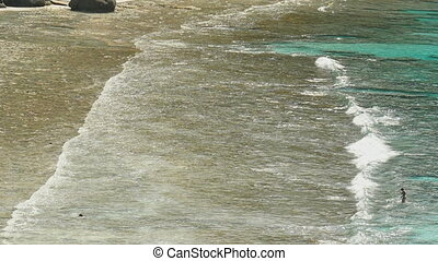 Surf waves on the beach of Similan - Lonely girl on the...