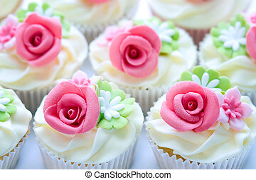 Wedding cupcakes decorated with pnk sugar roses