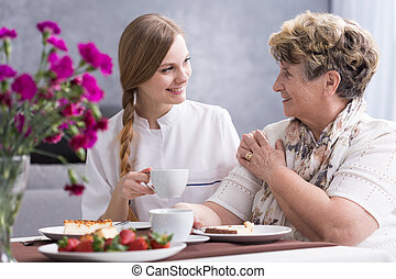 Today you look much better - Young caregiver and ill senior...
