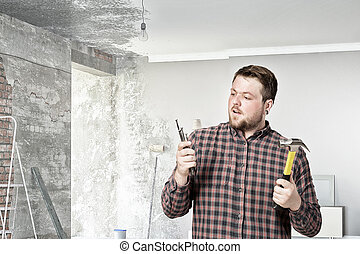 Guy with construction tools Mixed media - Casual man in...