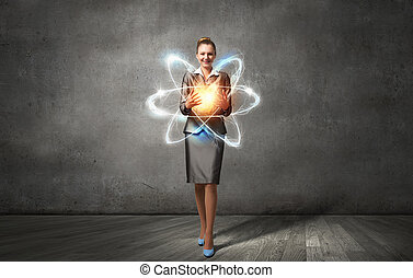 Woman scientist presenting atom research concept Mixed media...