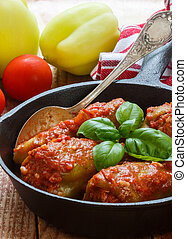 Bulgarian peppers stuffed with meat and rice with tomato...