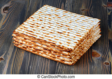 matzoh over wooden background - matzo flatbread for Jewish...