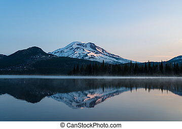 Serene view of mountain reflected in lake - Mountains in the...