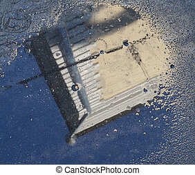 Reflection in a puddle - Reflection in the puddle in the...