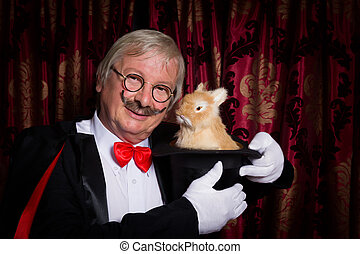 Magician with mustache - Funny illusionist on stage with a...
